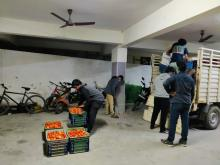 IT Employees unloading the Tomato load